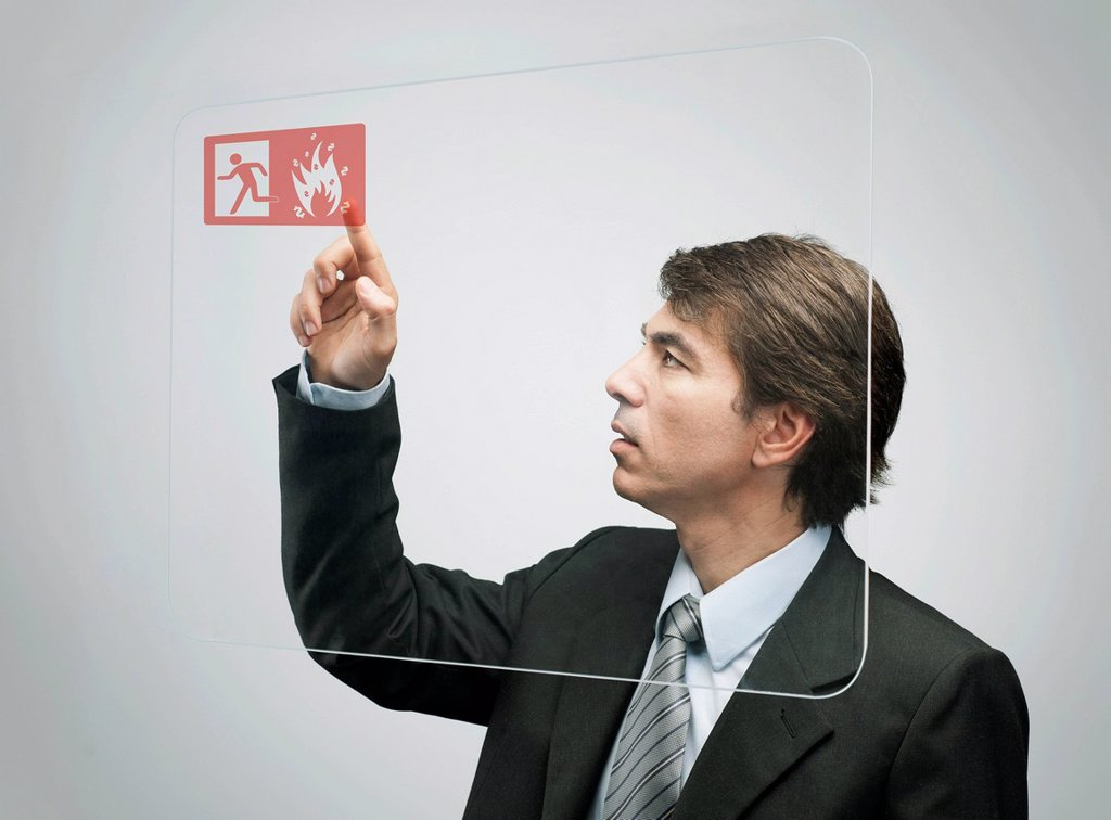 Stock Photo: 1569R-9077175 Businessman using advanced touch screen technology