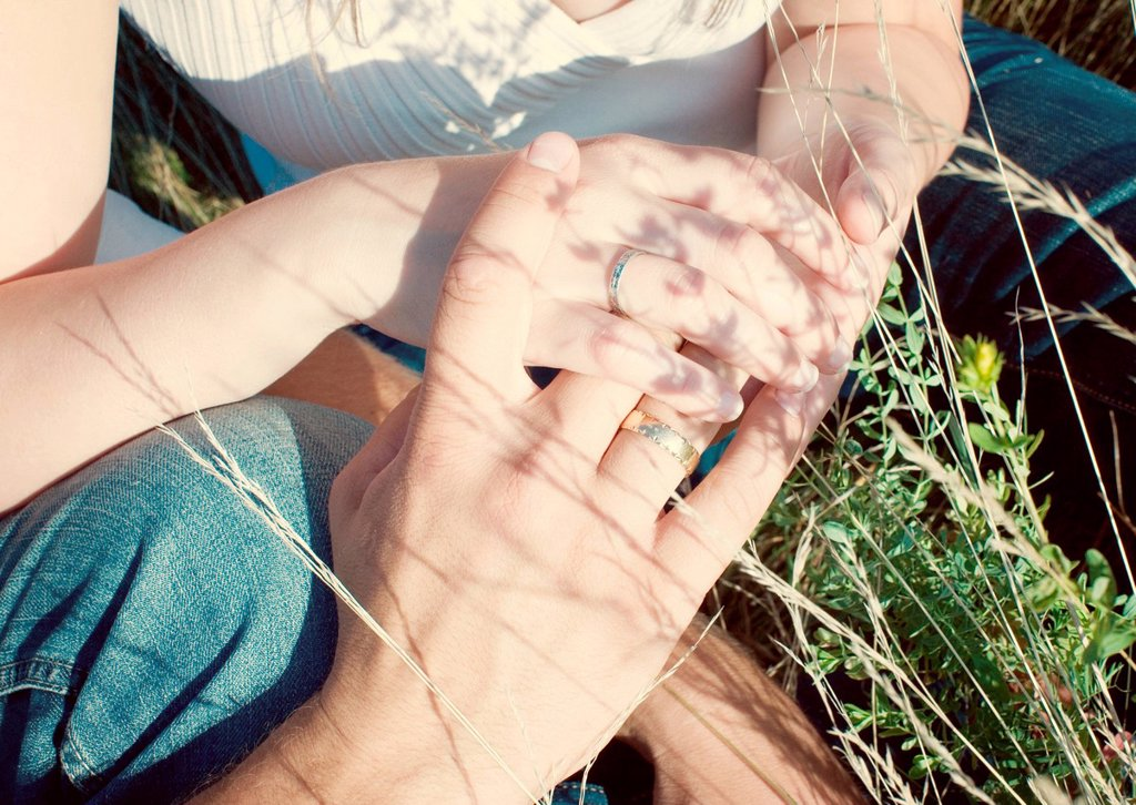 Stock Photo: 1569R-9077306 Couple holding hands, cropped