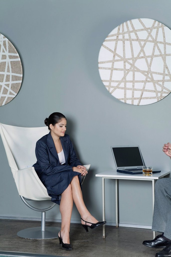 Stock Photo: 1569R-9077359 Young businesswoman contemplating during meeting