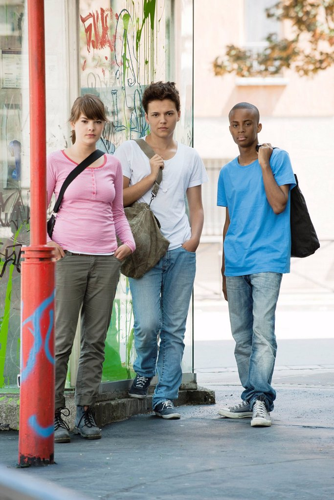 Young people standing side by side : Stock Photo