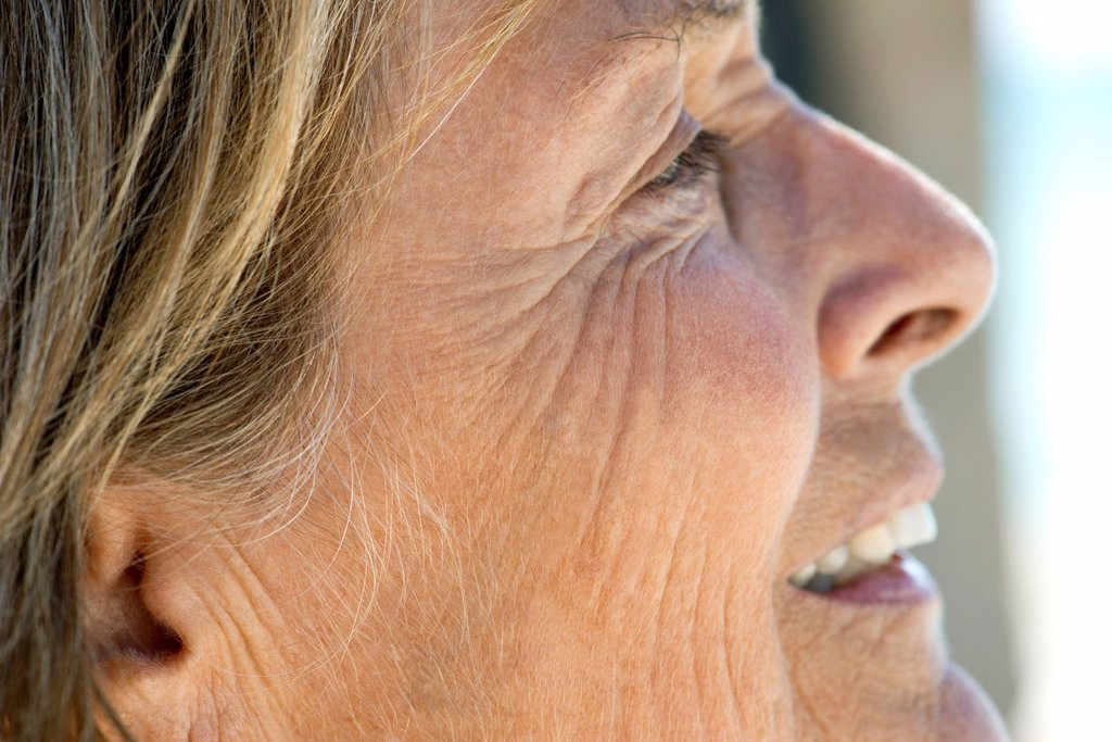 Stock Photo: 1569R-9077795 Face of senior woman, cropped