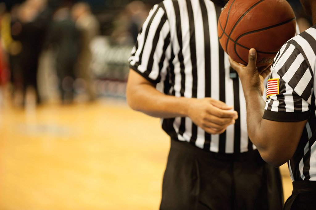 Stock Photo: 1569R-9077814 Basketball referees, cropped