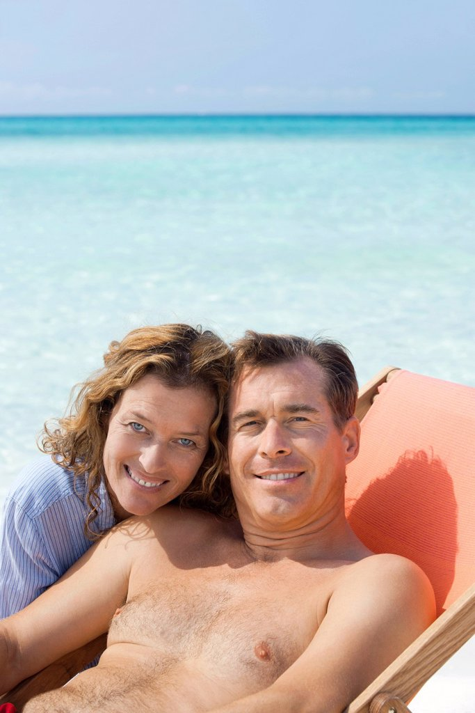 Stock Photo: 1569R-9077857 Couple spending time at beach, portrait