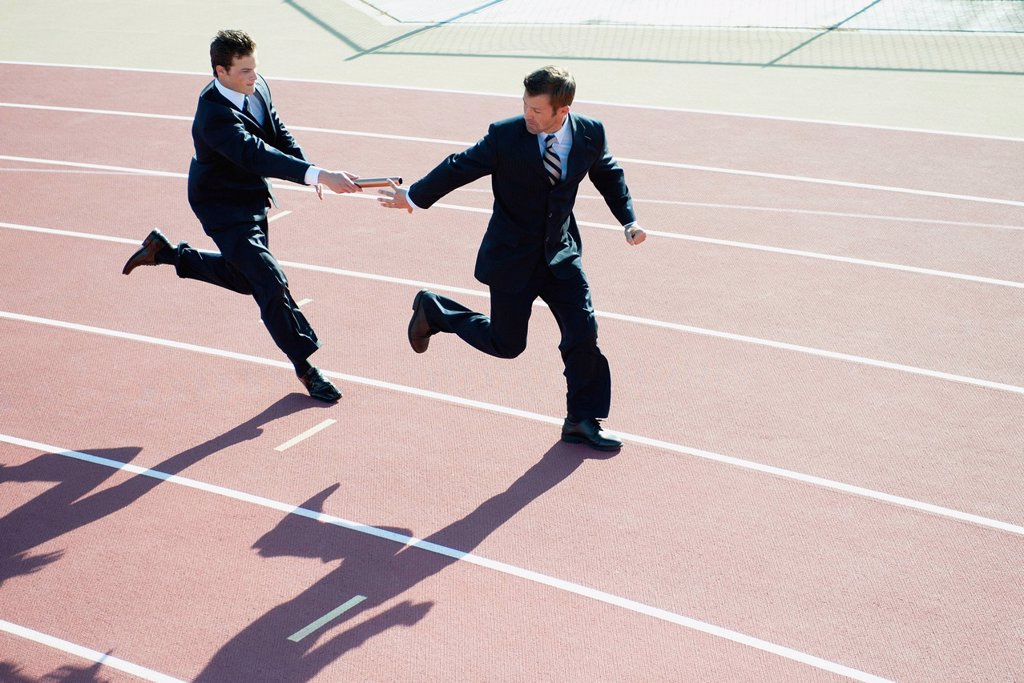 Businessmen running relay race : Stock Photo