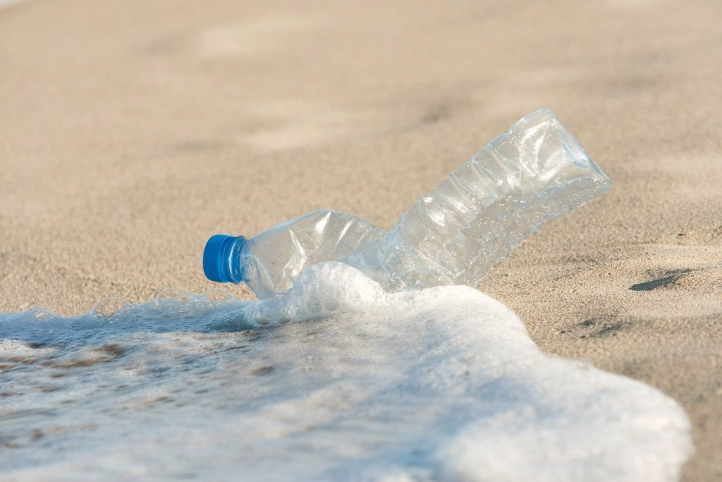 Stock Photo: 1569R-9078109 Abandonded plastic bottle on beach