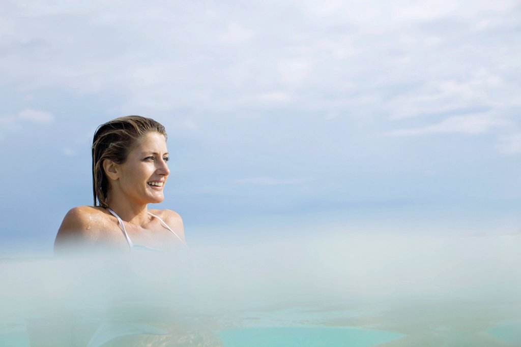 Woman relaxing in water : Stock Photo
