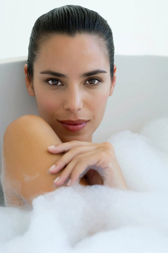 Woman taking bubble bath : Stock Photo