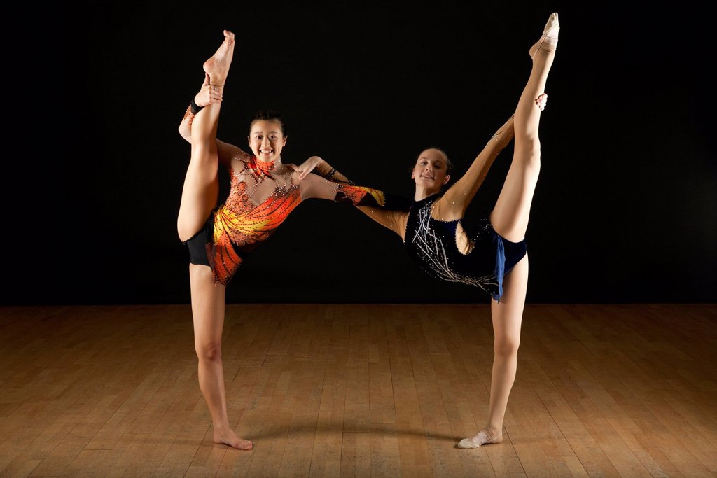 Stock Photo: 1569R-9078867 Gymnasts performing standing splits together, portrait