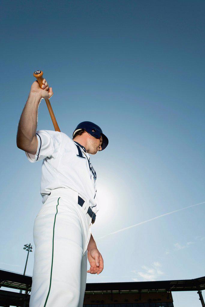 Stock Photo: 1569R-9078995 Baseball player holding baseball bat across shoulders