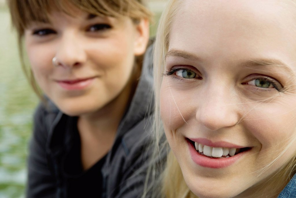 Stock Photo: 1569R-9079423 Young women smiling, portrait