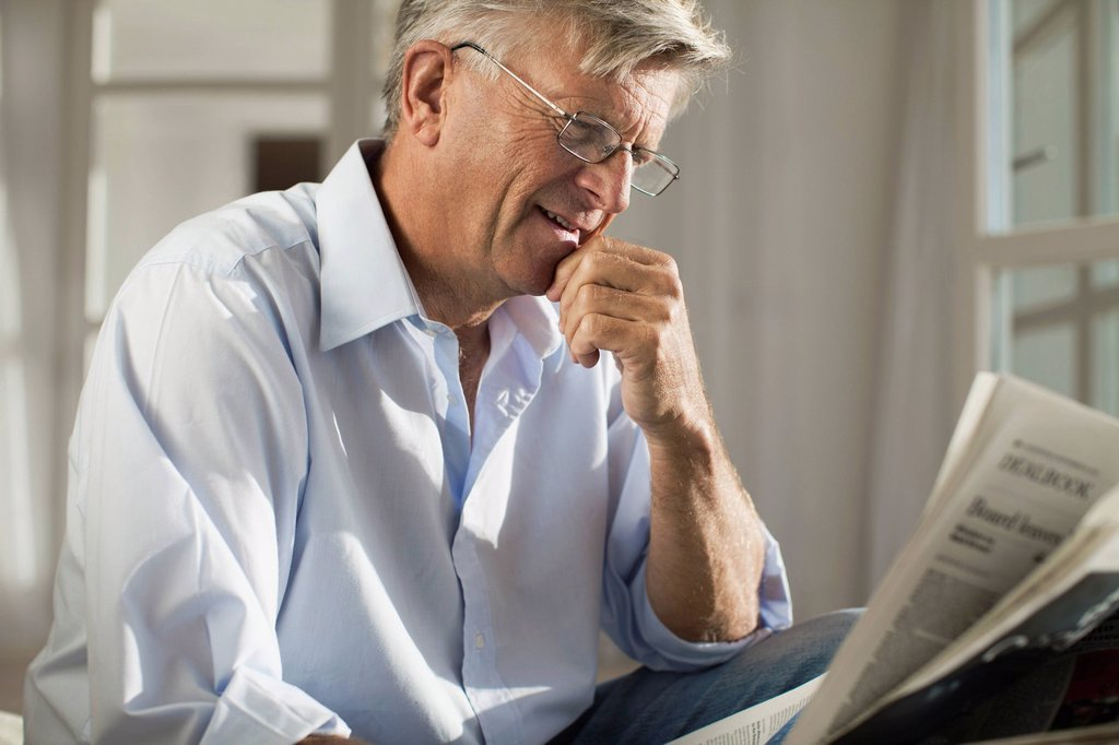 Stock Photo: 1569R-9079482 Senior man reading newspaper