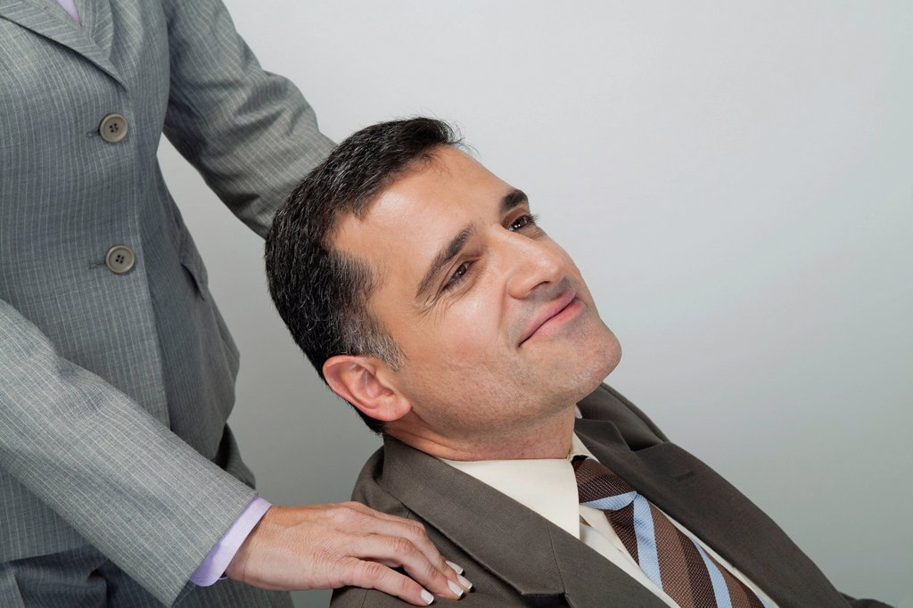 Mature businessman having shoulders massaged : Stock Photo