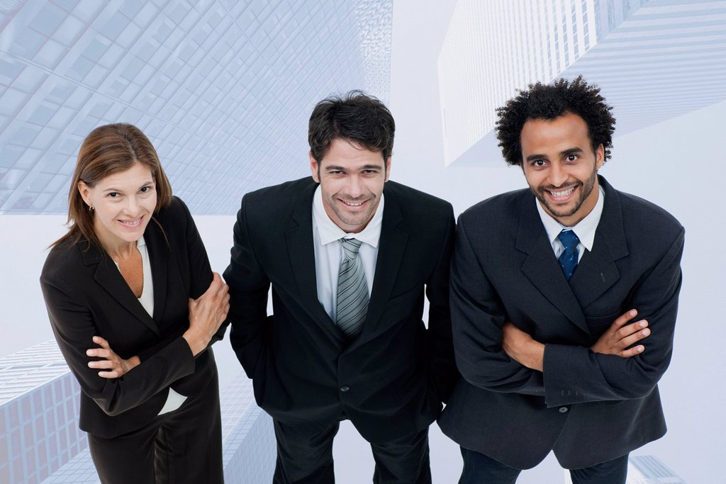 Stock Photo: 1569R-9080063 Team of executives smiling confidently with skyscrapers superimposed on background