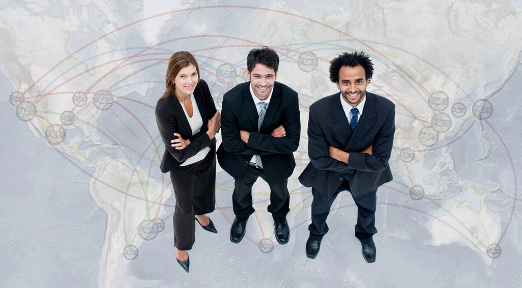 Stock Photo: 1569R-9080163 Executives standing on world map