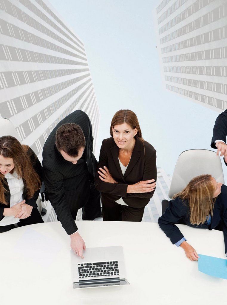 Stock Photo: 1569R-9080205 Mature businesswoman meeting with colleagues, skyscrapers superimposed on background