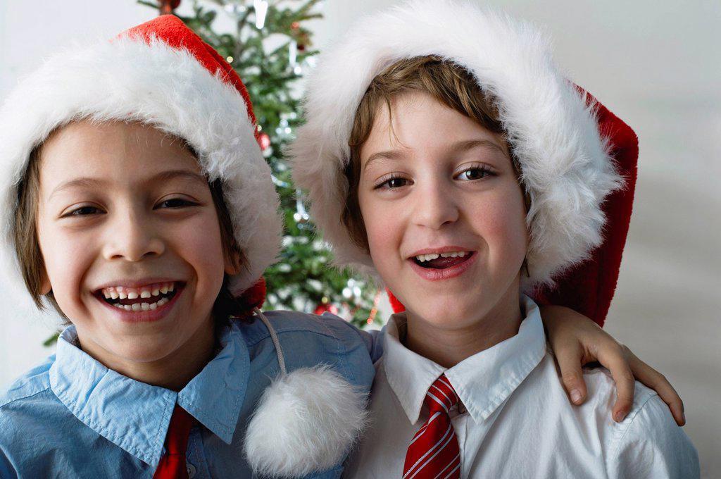 Boys wearing Santa hats, portrait : Stock Photo
