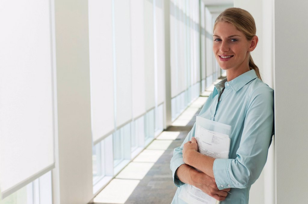 Stock Photo: 1569R-9080357 Young businesswoman, portrait