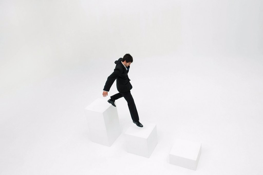 Businessman descending steps : Stock Photo