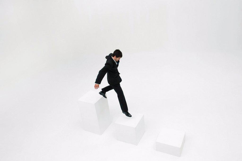 Stock Photo: 1569R-9080658 Businessman descending steps