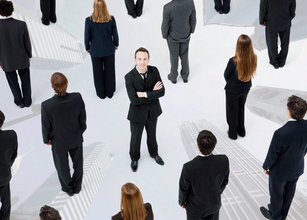 Stock Photo: 1569R-9080681 Ambitious businessman standing out from the crowd