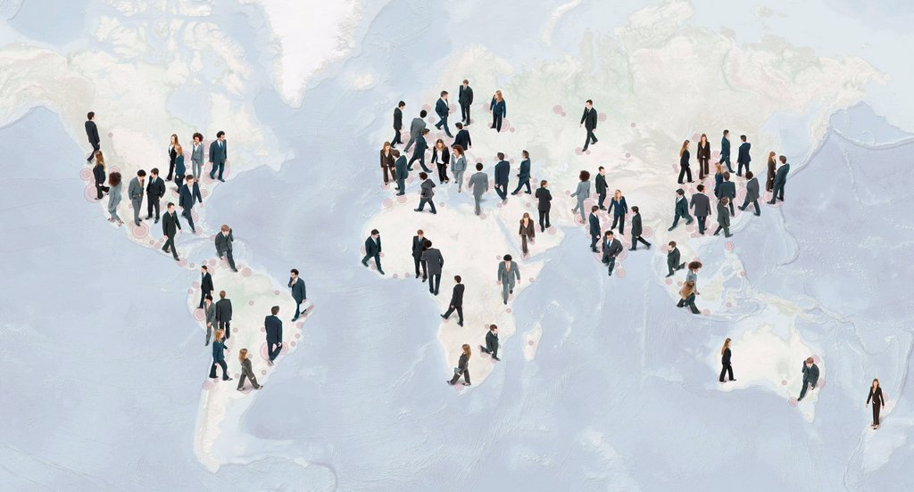 Stock Photo: 1569R-9080711 Large group of businesspeople walking on world map
