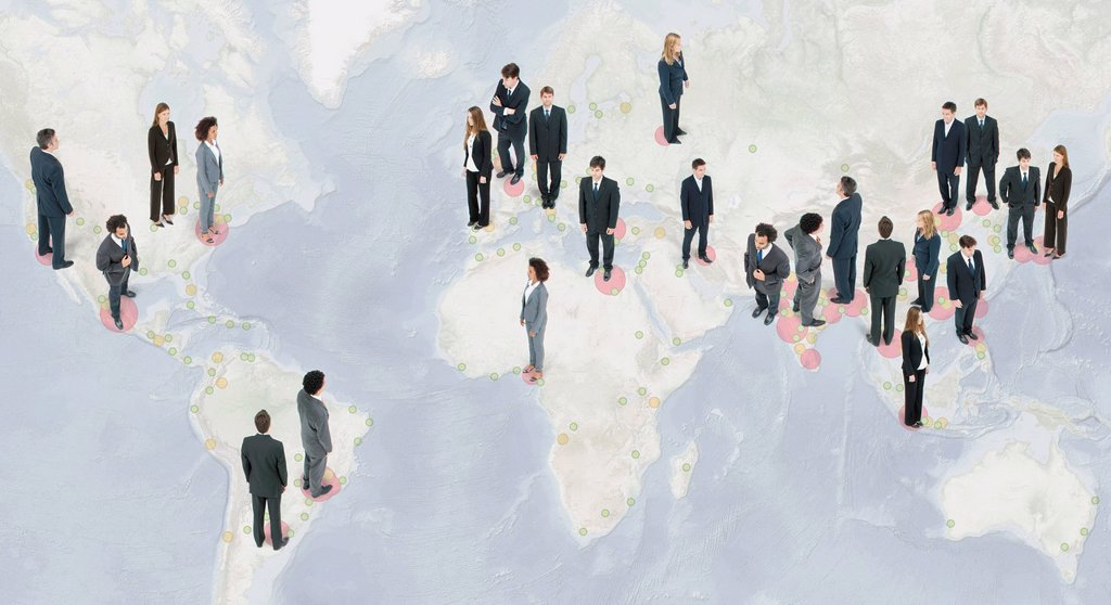 Stock Photo: 1569R-9080719 Large group of business people standing on world map