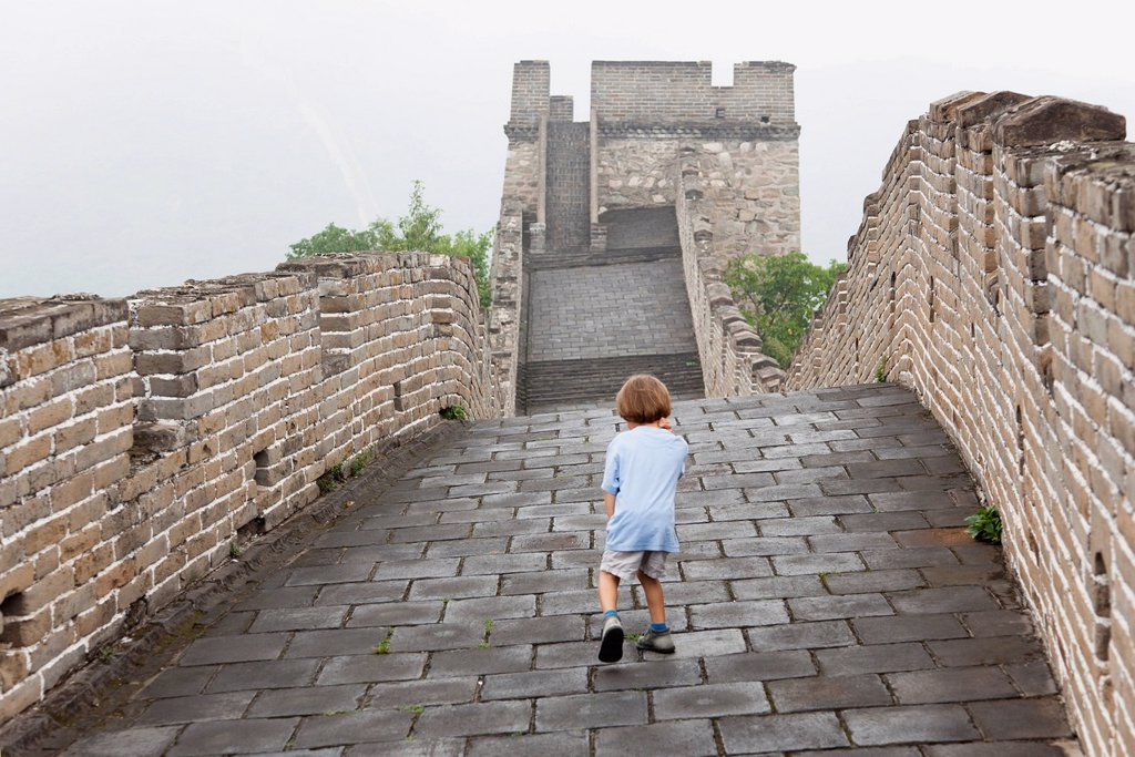 China, boy walking on Great Wall of China : Stock Photo