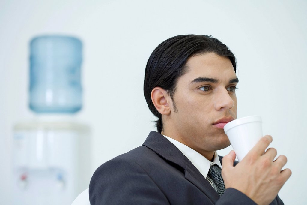 Stock Photo: 1569R-9080821 Young businessman taking a coffee break
