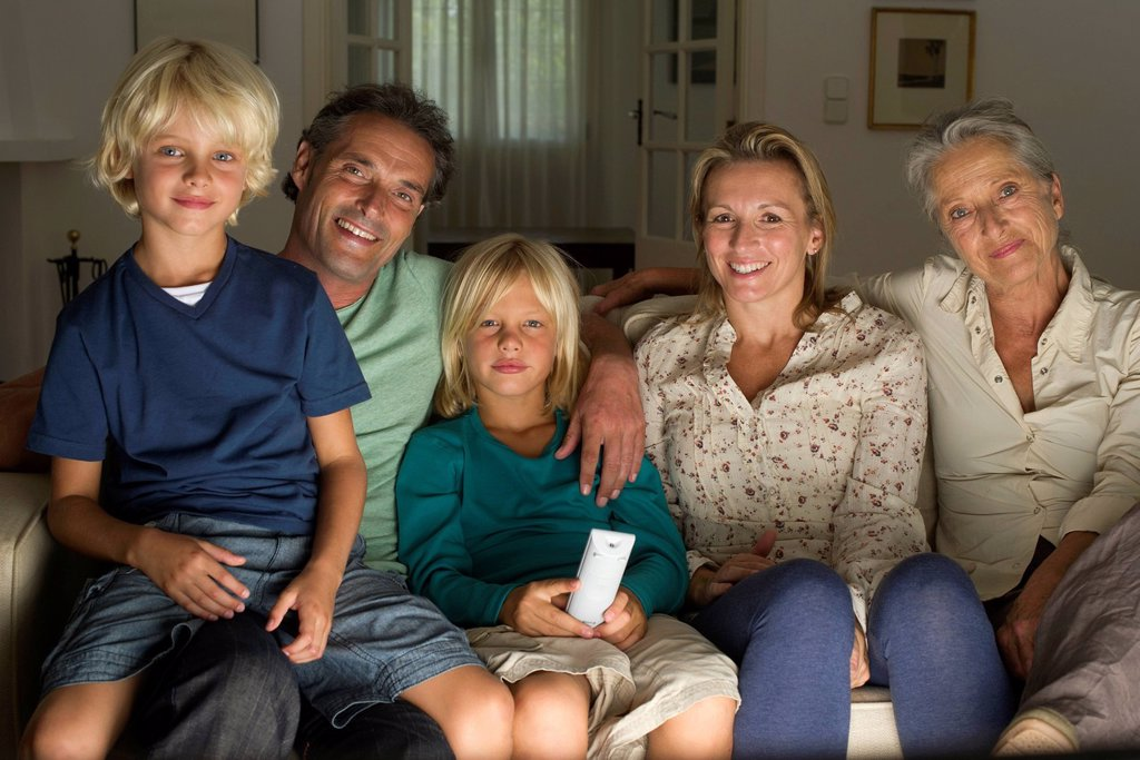 Stock Photo: 1569R-9080832 Multi_generation family watching TV together, portrait