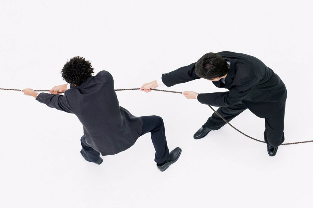 Stock Photo: 1569R-9080854 Businessmen playing tug_of_war