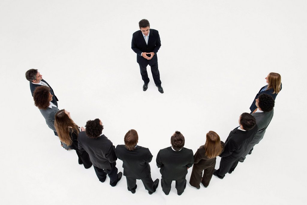 Stock Photo: 1569R-9080858 CEO meeting with team of business associates