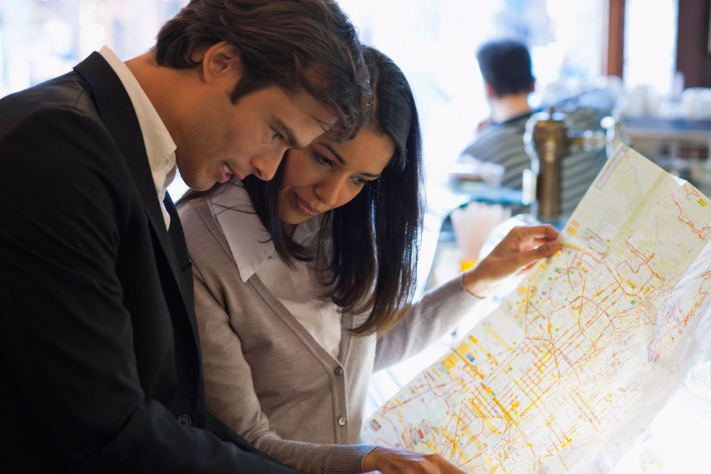 Couple looking at map together : Stock Photo