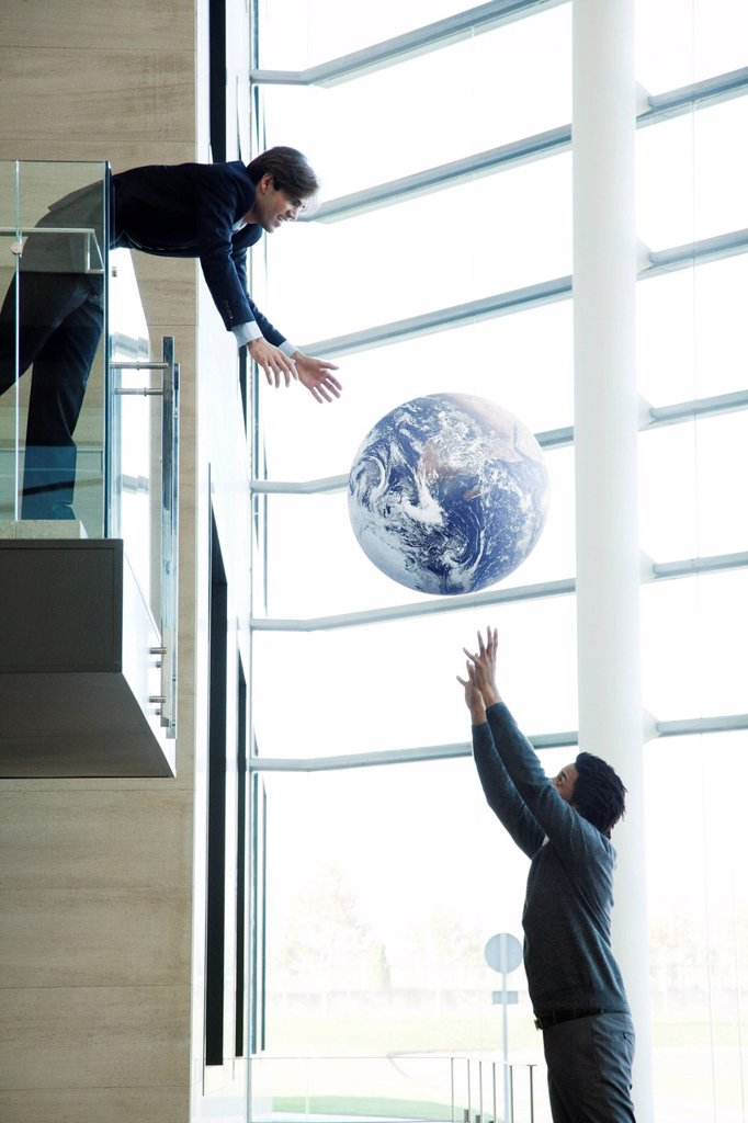 Stock Photo: 1569R-9082903 Colleagues throwing ball in lobby