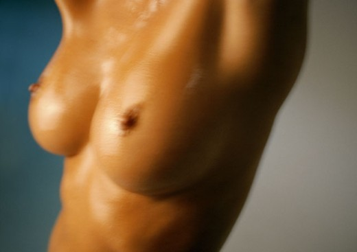 Woman´s bare chest, close-up : Stock Photo