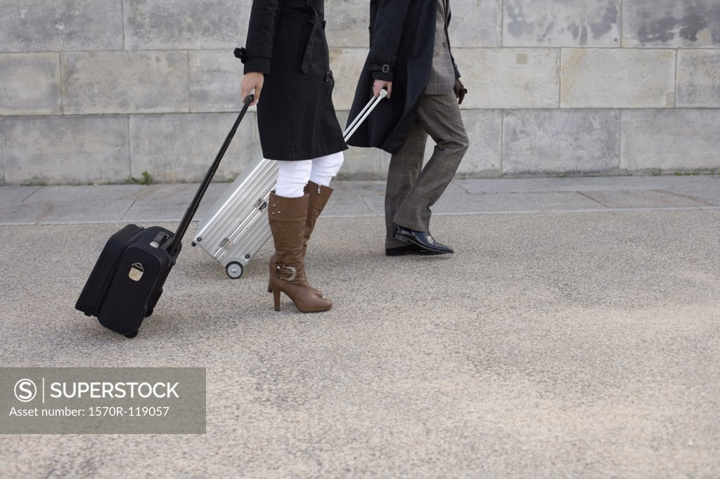 Stock Photo: 1570R-119057 Two people walking with luggage