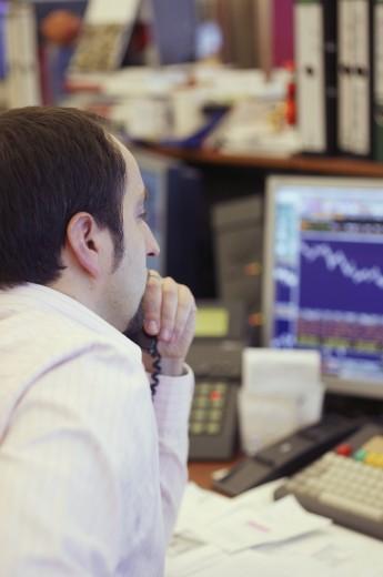 Businessman talking on phone at desk  : Stock Photo