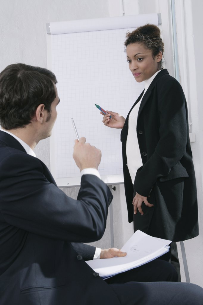 Stock Photo: 1570R-100014 Businessman and businesswoman in meeting