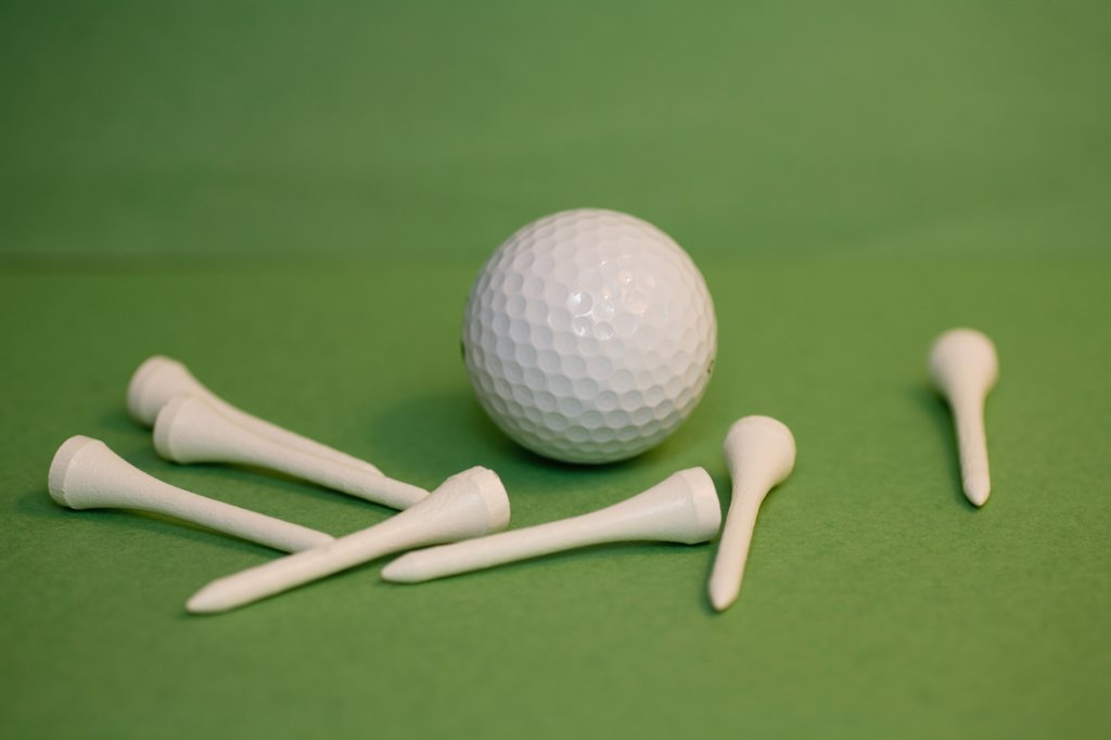 Stock Photo: 1570R-102142 A golf ball with golf tees