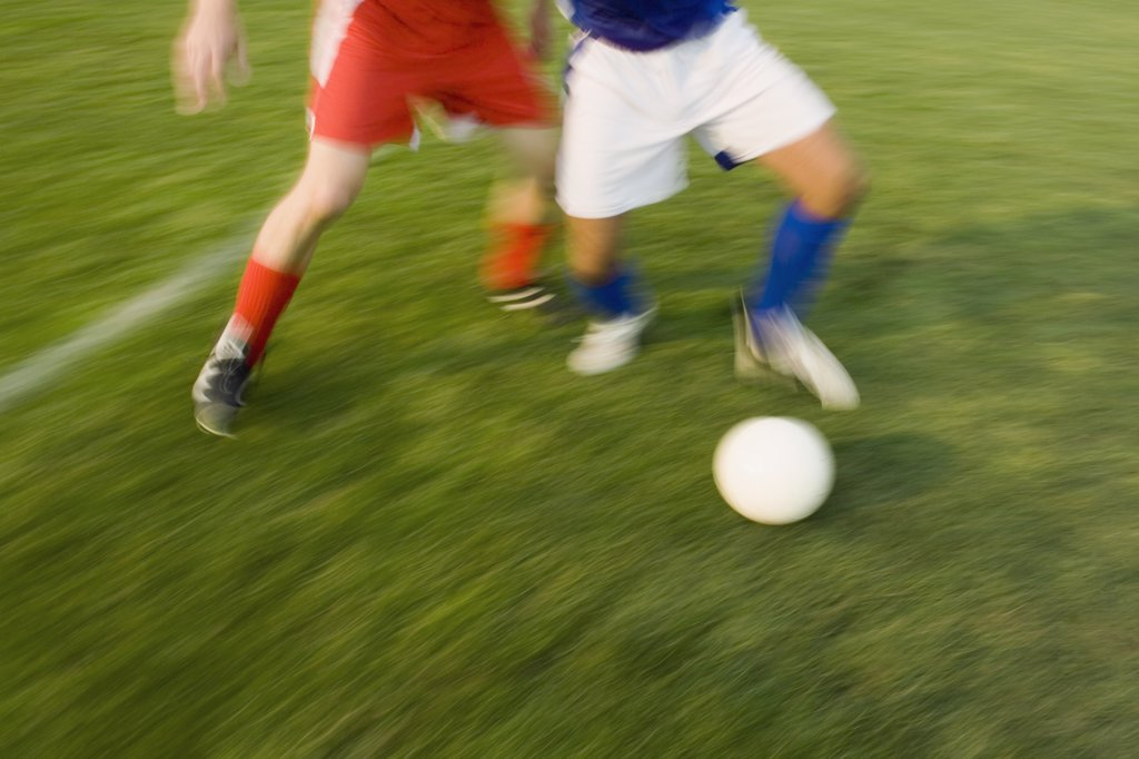 Two people playing soccer : Stock Photo