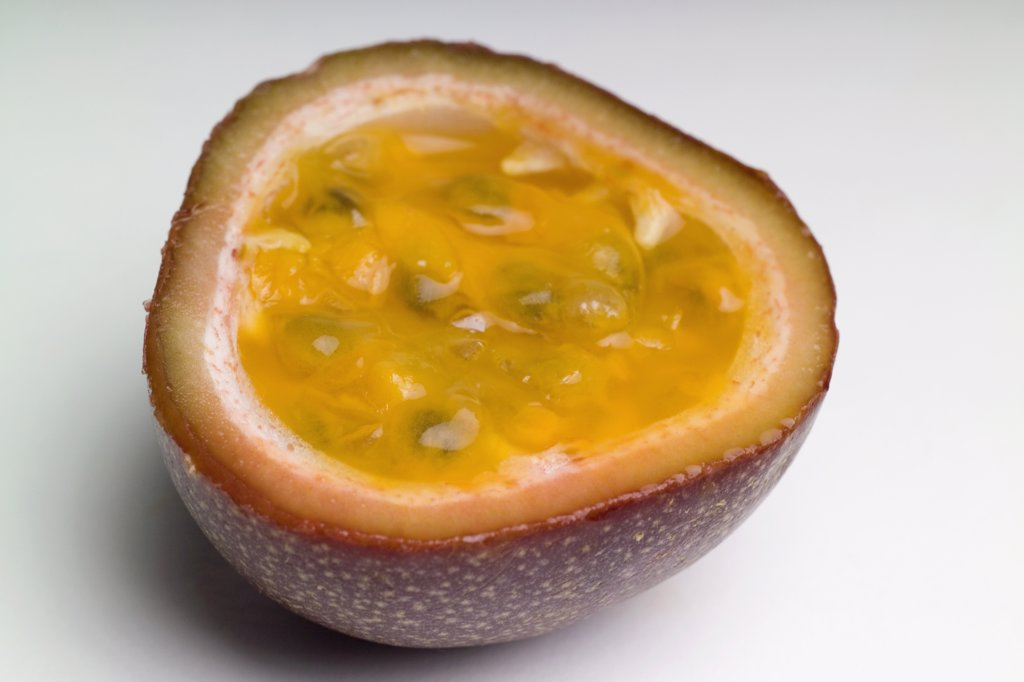 Cross section of passion fruit : Stock Photo