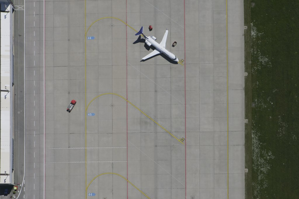 Aerial view of parked plane on airport tarmac : Stock Photo