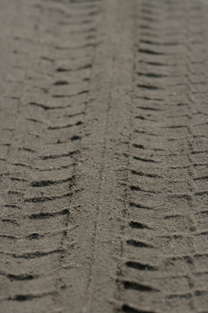 Stock Photo: 1570R-114382 Close-up of tire track in sand
