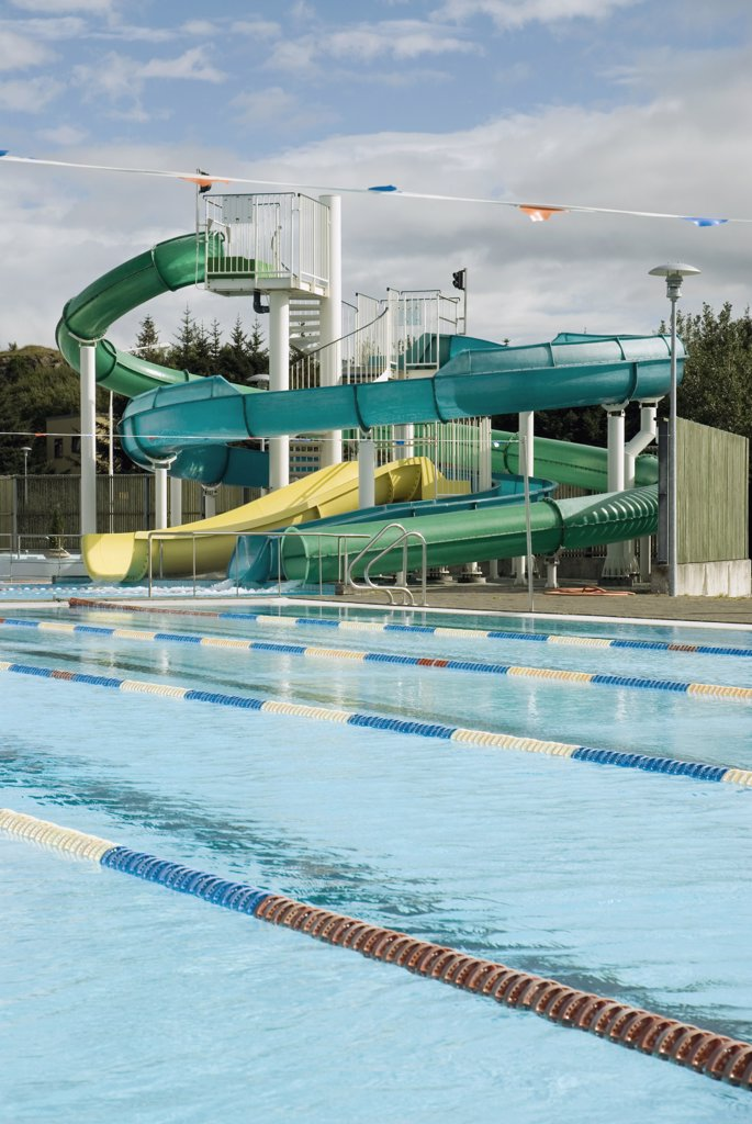 Stock Photo: 1570R-114992 Empty swimming pool and water slides