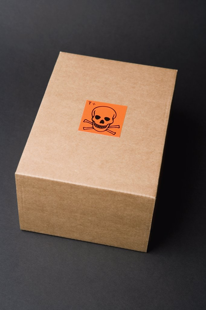 Cardboard box with toxic label : Stock Photo