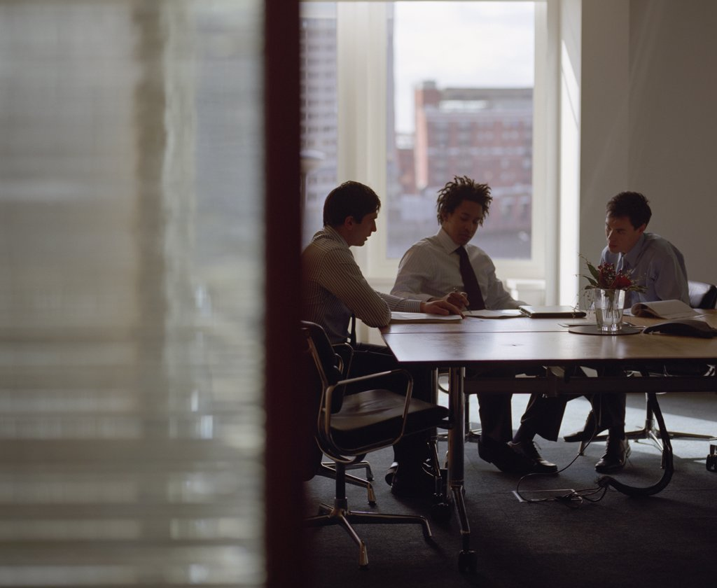 Three businessmen meeting in conference room : Stock Photo