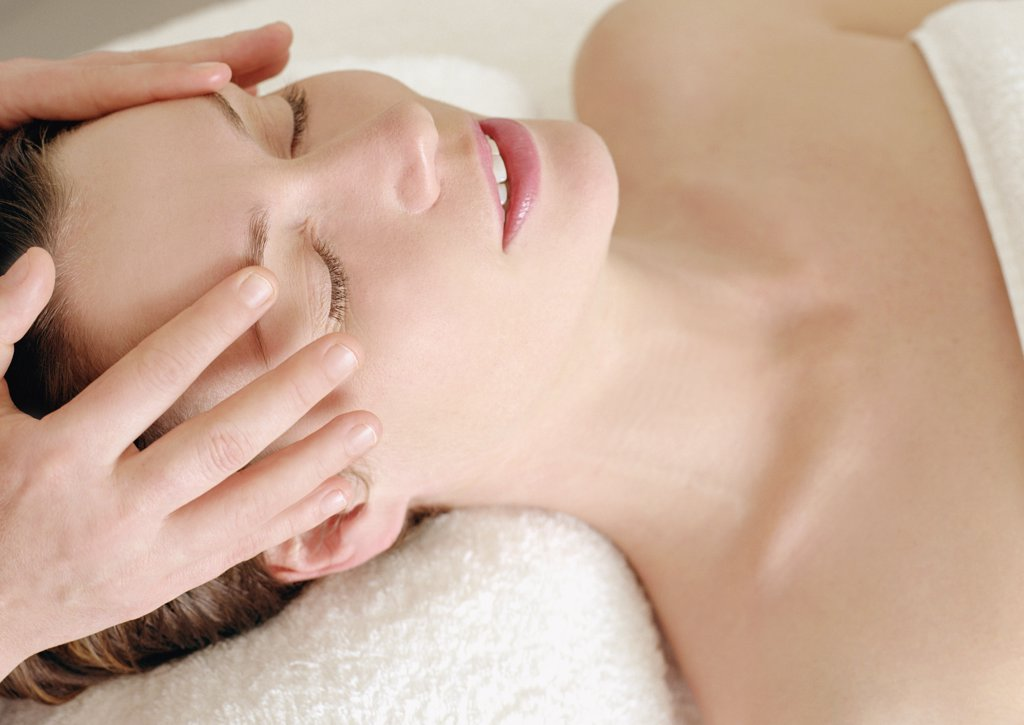 Woman receiving a massage at a beauty spa : Stock Photo