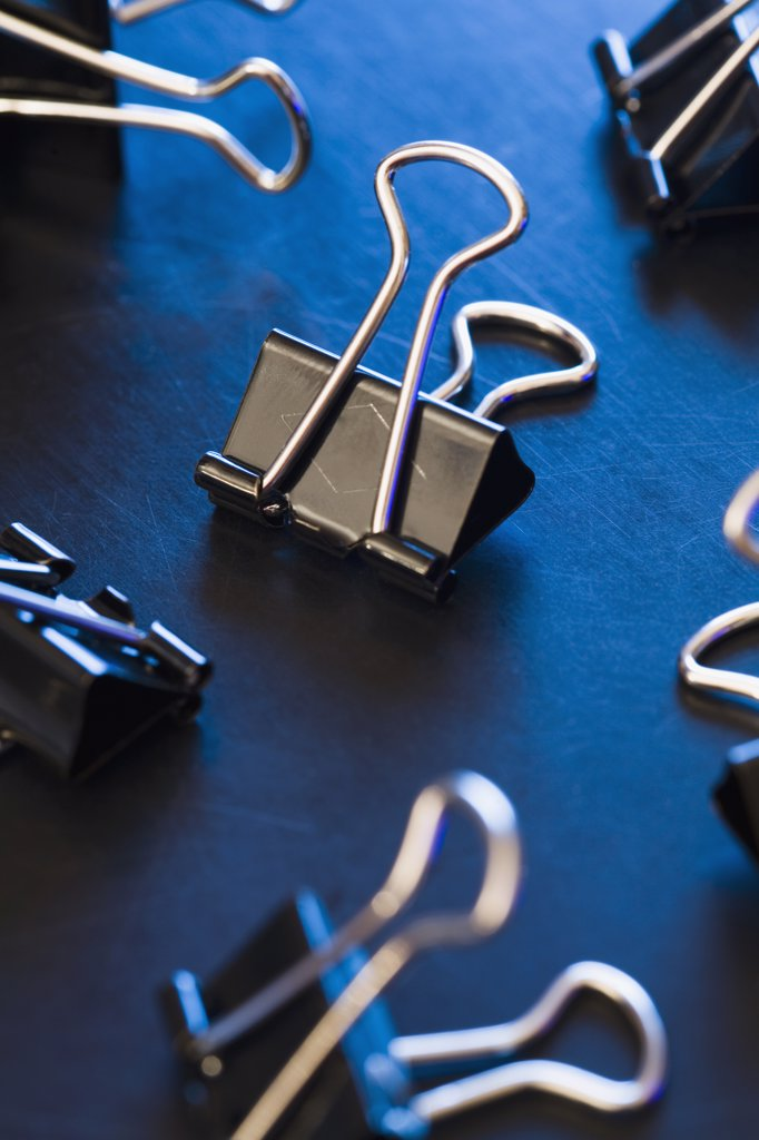 Stock Photo: 1570R-115984 Binder clips on a desk