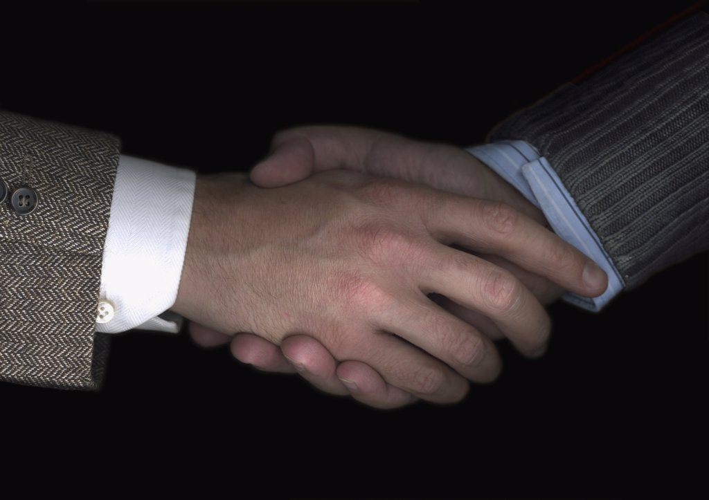 Stock Photo: 1570R-116045 Two businessmen shaking hands