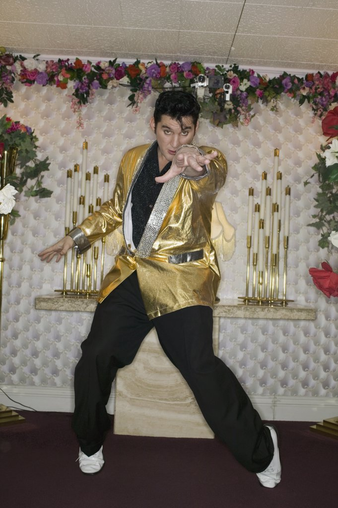 Stock Photo: 1570R-116135 Elvis impersonator standing at the altar in a wedding chapel, Las Vegas, Nevada