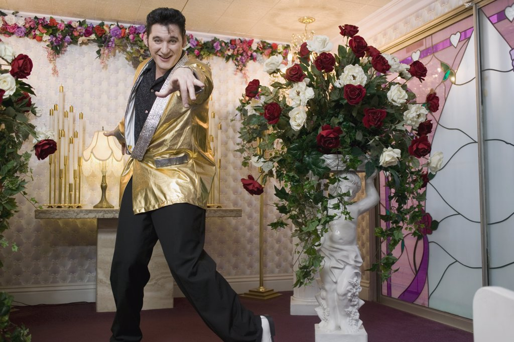 Stock Photo: 1570R-116139 Elvis impersonator standing at the altar in a wedding chapel, Las Vegas, Nevada